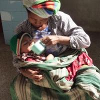 mother-feeding-child